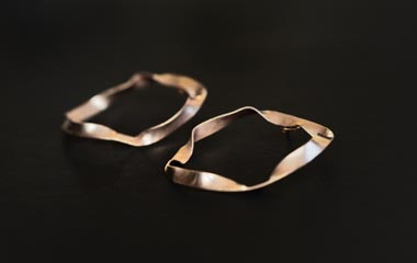 tridimensional form and organic shapes, irregular and often asymmetrical as naturally occurring, these earrings are handmade